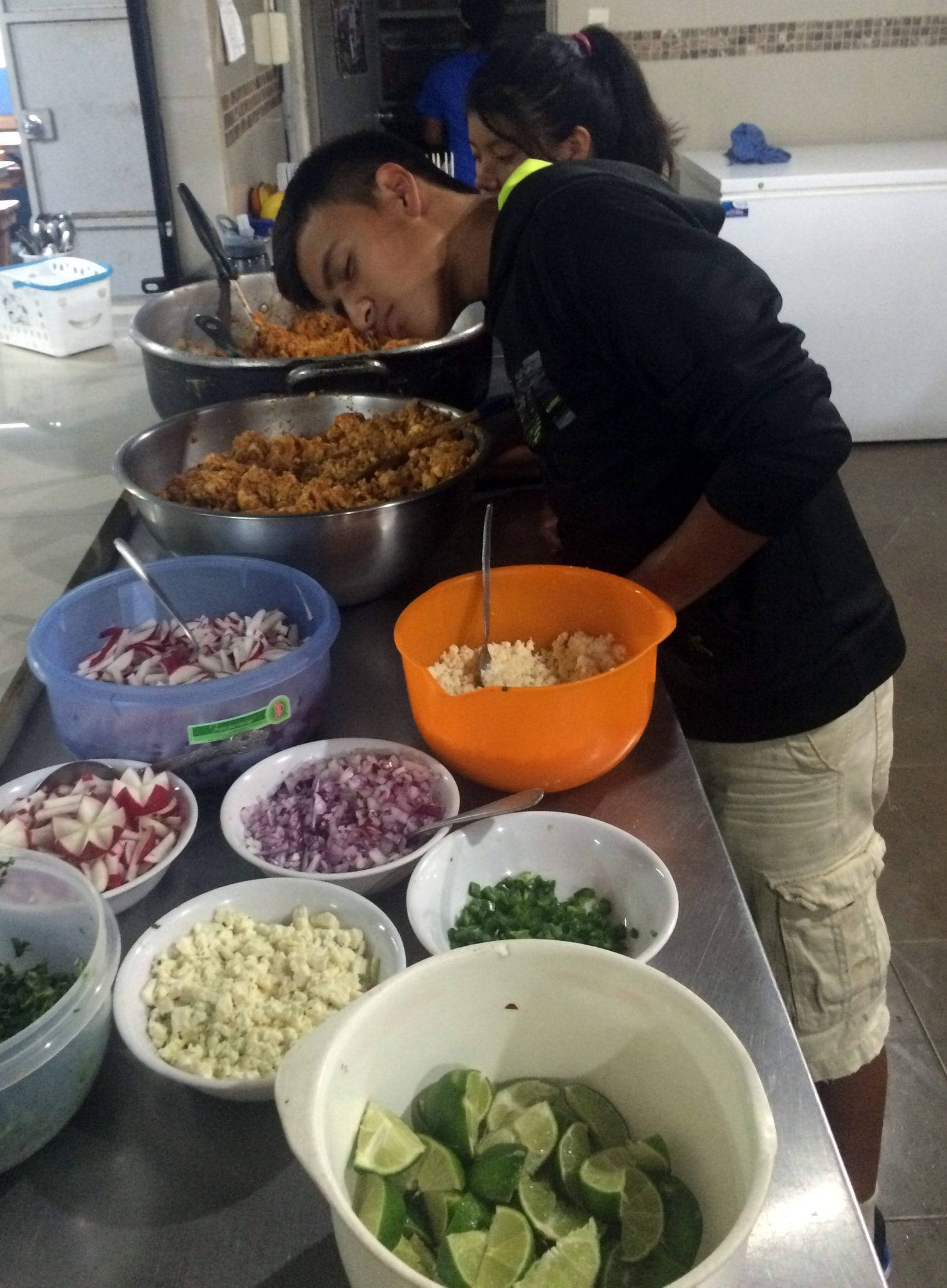 One of the students putting the finishing touches on their meal