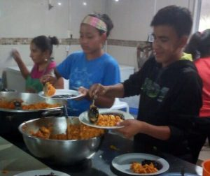 students serving the meal they cooking in cooking class
