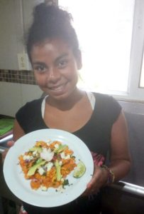One of our students demonstrating the Chilaquiles she made