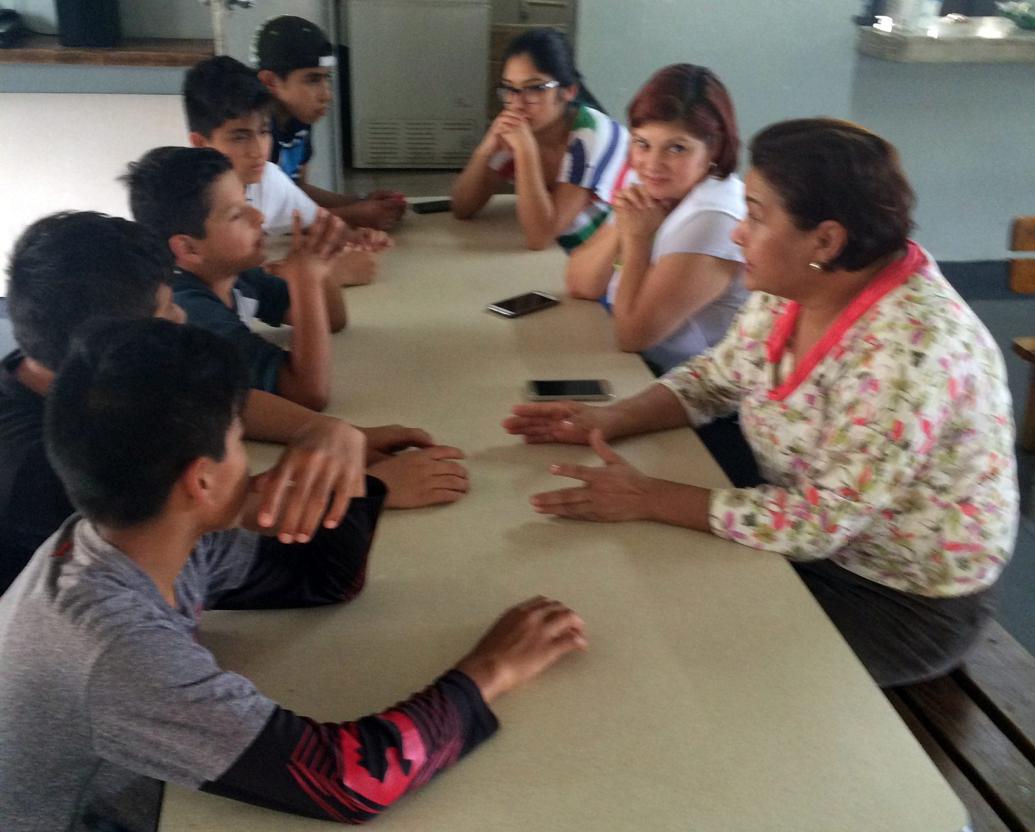 Volunteers from Casa de Libertad helping with cooking classes at the orphanage Fundaninos