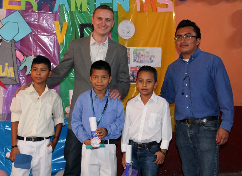 Tim with students at the year end graduation