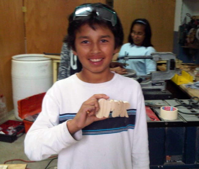 Omar in woodworking class